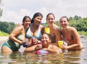 Girls with drinks on float trip